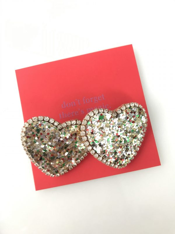 Sparkly heart posts with a rim of little crystals add a little dazzle to your everyday! Dazzle Does It are lightweight, available in two colors